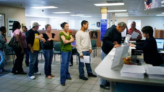 Job seekers stand in line at the employment help center in Miami, Florida.