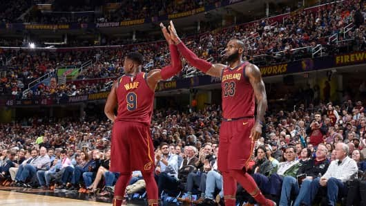 Dwyane Wade #9 of the Cleveland Cavaliers and LeBron James #23 of the Cleveland Cavaliers high five during the game against the Chicago Bulls on October 24, 2017.
