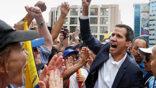 Juan Guaido, President of Venezuela's National Assembly, reacts during a rally against Venezuelan President Nicolas Maduro's government and to commemorate the 61st anniversary of the end of the dictatorship of Marcos Perez Jimenez in Caracas, Venezuela January 23, 2019.