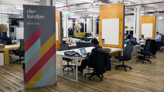 Tech entrepreneurs work at the Rise London accelerator in London.